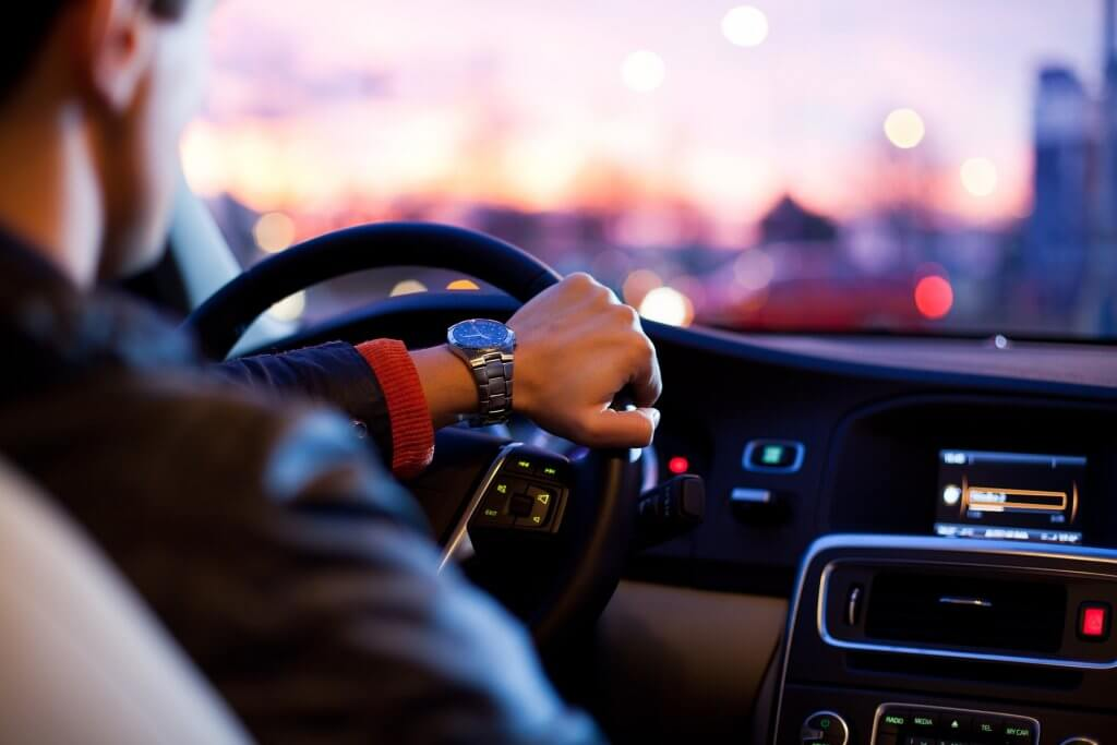 Man wearing a watch and driving